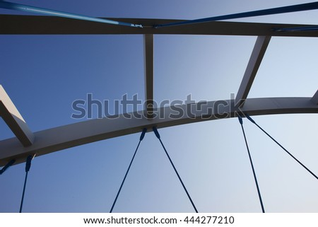 Details of a modern bridge over blue sky