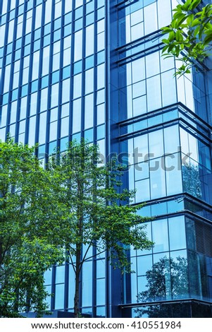details of a modern office building with a tree - stock photo