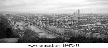 Details of a panoramic view of Lyon in black and white.