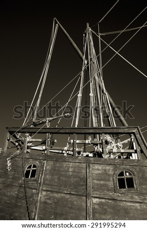 Details of a Portuguese ship from the time of discovery seeing rigging, masts, window and small aft cannon - stock photo