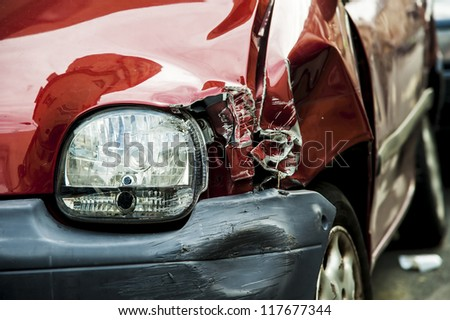 Details of a red car in an accident - stock photo