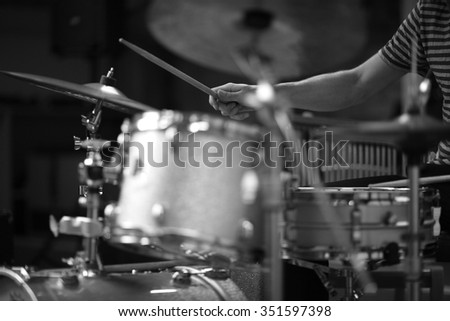 Details of a rock drummer playing - stock photo
