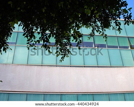 Details of abstract modern design building with glass clad facade - stock photo