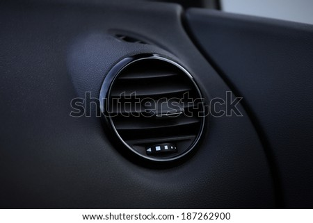 Details of air conditioning (car ventilation system) in modern car - stock photo