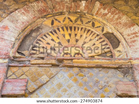 Details of an ancient roman tomb (Tomb of the Small Arches) in the Necropolis of Ostia old town, Rome, Italy, heritage of early italian history, now travel destination for tourists. - stock photo