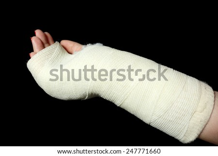 Details of an arm cast isolated on black background.