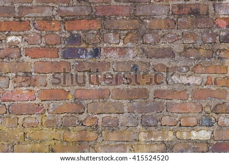 Details of an old chimney and weathered roof with cedar shingles on an old brick house. - stock photo