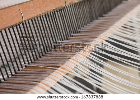 Details of an old fashioned fabric loom.