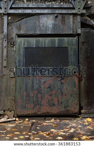 Details of an old iron door at a military base