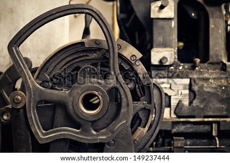 details of an old printing press, in vintage colors - stock photo