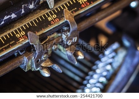 Details of an old typewriter, metering of paper position.  - stock photo