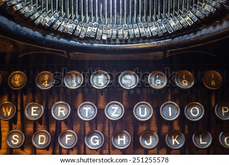 Details of an old typewriting machine, retro style with dusty metal and buttons.  - stock photo