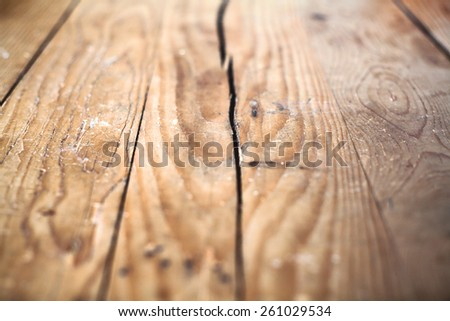 Details of an old wooden table, a cracked upper plate.  - stock photo