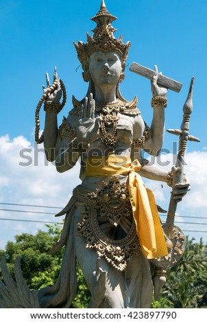 Details of Balinese statue, Hinduism figures in Bali. Clear blue sky in Indonesia - stock photo