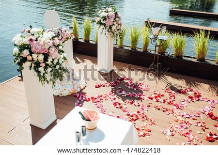 details of beautiful wedding ceremony in the park on a sunny near river