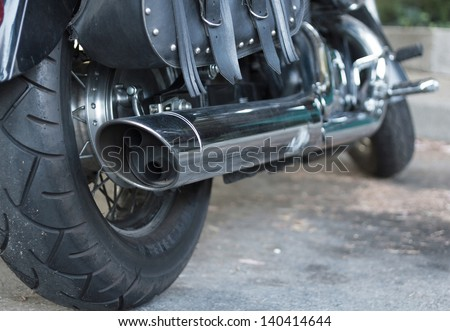 Details of black cruiser motorcycle, rear view. - stock photo
