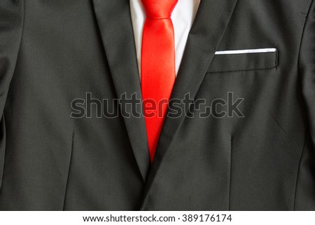Details of business man suit, white shirt, red tile, smart coat suit