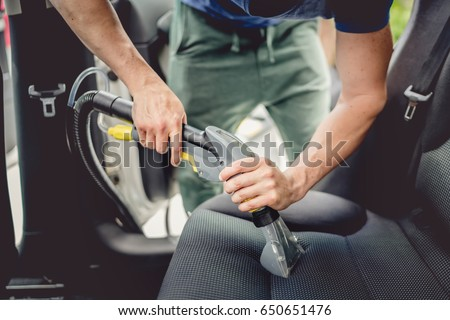 details car cleaning male using professional stock photo 650651476 shutterstock. Black Bedroom Furniture Sets. Home Design Ideas
