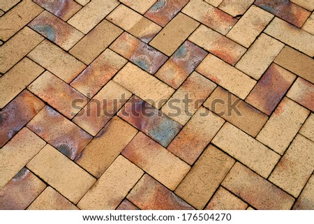 Details of different tones of brown geometric shaped stone garden tiles floor - stock photo