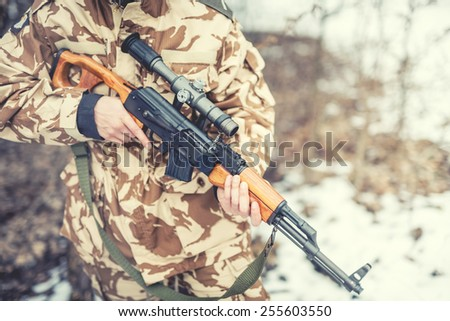 details of equipment and gun on military ranger - War, hunting or protection concept with man - stock photo