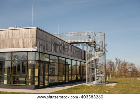 details of facade on industrial building - stock photo