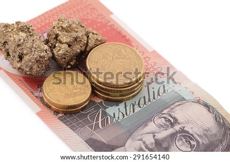 Details of gold nuggets and coins on Australian 20 dollar note. Isolated white background. One dollar coin has kangaroos on it while two dollar coin depicts Aboriginal man. - stock photo