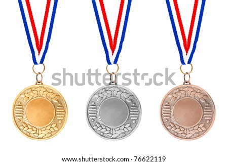 Details of gold, silver and bronze medals on red, white and blue ribbons on white background - stock photo