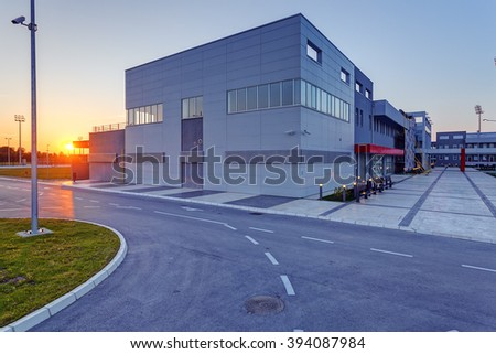 Details of gray and red facade on modern residential building made of aluminum panels.  - stock photo