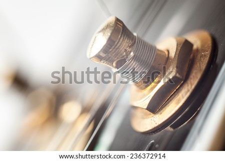 Details of guitar pin in macro, with good background blur.  - stock photo
