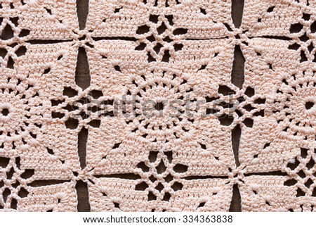 Details of hand-crocheted tablecloth - stock photo