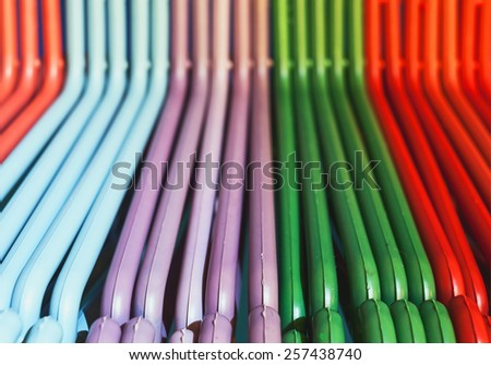 Details of hangers, in various colors made of plastic.  - stock photo