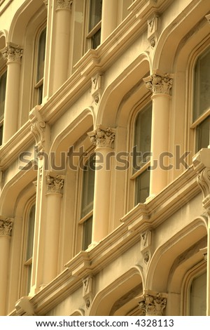 Details of historic building windows architecture in sepia tone - stock photo