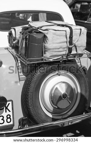Details of immaculately maintained vintage classic car in black and white - stock photo