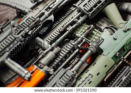 Details of many  confiscated modern rifles supplied smuggled. detained party of illegal weapons. - stock photo