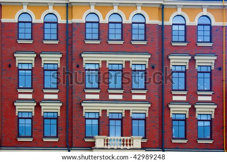 Details of modern building with by beautiful windows - stock photo