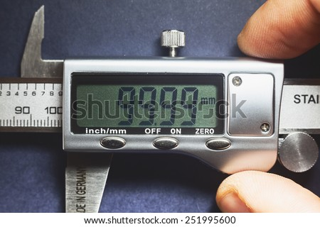 Details of modern measuring tool, digital display showing precise dimension in two decimals.  - stock photo
