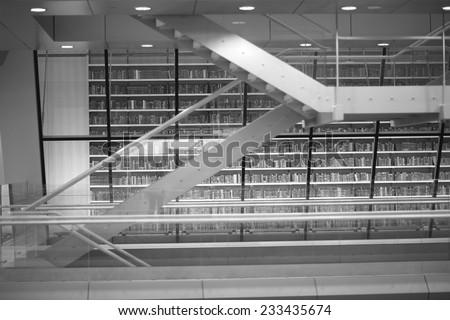 Details of modern public library interior, monochrome - stock photo