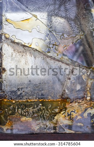 Details of old glass as found on antique trunk. - stock photo