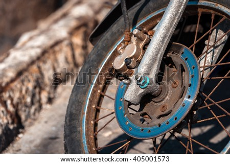 Details of old rusty motorbike wheel