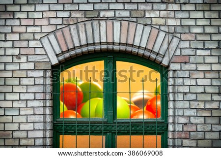Details of old town architecture. Green window in old brick wall. Budapest, Hungary, Europe travel. - stock photo