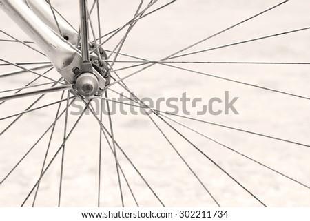 Details of retro bicycle wheel, sepia tone - stock photo