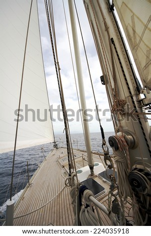 Details of sailboat in a Mediterranean navigation: deck and sails - stock photo