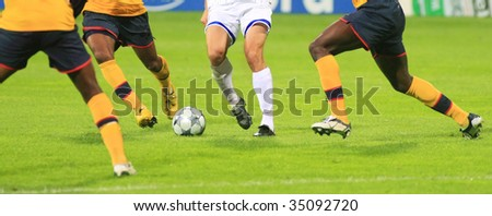 details of soccer match with many players in action - stock photo