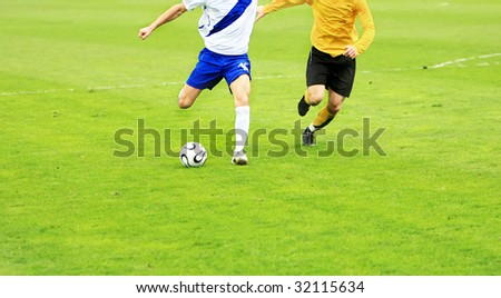 details of soccer match with two players in action - stock photo
