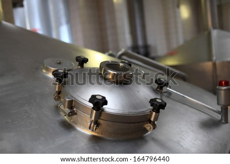Details of stainless fermentation vat of a brewery - stock photo