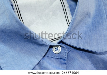 details of striped shirt with blank label - stock photo