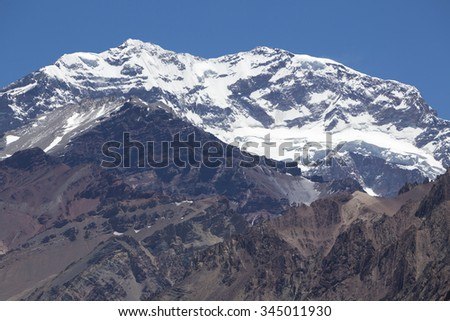 Details of the Aconcagua mountain peak with clear blue sky at the Aconcagua National Park. Landmark near Mendoza, Argentina