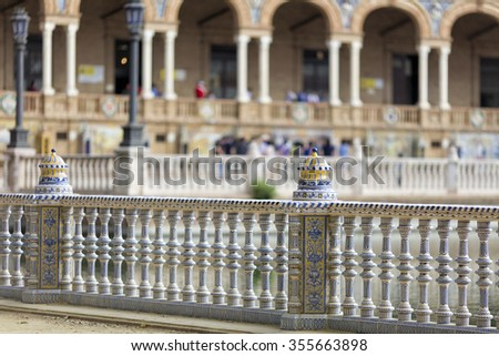Details of the famous historical Spanish Square in Seville, built for the Ibero-American Exhibition of 1929. Plaza de Espana is a semi-circular brick building, with a tower at either end. - stock photo