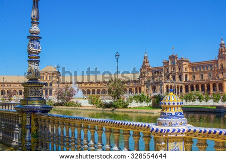 Details of the railing decorated ceramic Pond from the famous Plaza of Spain in Seville, Spain - stock photo