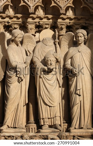 Details of three statues on a the front of the Cathedral Notre Dame de Paris, in France - stock photo